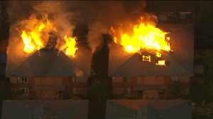 Firefighters battled dramatic flames at two adjacent apartment buildings in Anaheim on Friday, Nov. 6, 2015. (Credit: KTLA)
