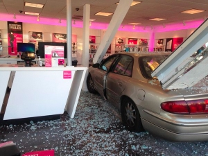 The Garden Grove Fire Department tweeted this image of a car inside of a T-Mobile store on Nov. 12, 2015.
