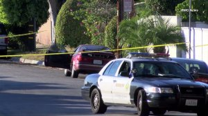 Homicide investigators respond after a body is found inside a vehicle in unincorporated West Whittier-Los Nietos on Nov. 29, 2015. (Credit: RMG News)