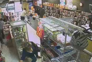 One member of a group of four female distraction thieves grabs a store employee's purse in an Oct. 29, 2015, crime in Corona that was caught on surveillance video.