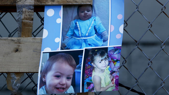 A photo of the three murdered Coronado girls displayed during a memorial vigil in 2014 are Xenia, 2 months, top; Sophia, 2, bottom right; Yazmine, 16 months, bottom left. (Credit: Anne Cusack / Los Angeles Times)