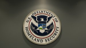 The logo of the Department of Homeland Security is seen at US Immigration and Customs Enforcement in Washington, DC, February 25, 2015. (Credit:  SAUL LOEB/AFP/Getty Images)