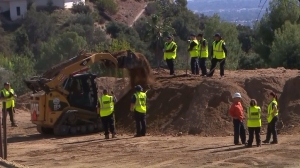 Los Angeles County coroner's workers dig in a canyon in Altadena on Nov. 4, 2015, three days after a human femur was found at the site. (Credit: KTLA)