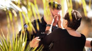 A Downey police officer is consoled after the body of slain Officer Ricardo Galvez was moved to the coroner's van on Nov. 19, 2015. (Credit: Al Seib / Los Angeles Times)