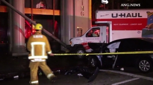 The driver of a U-Haul was arrested on Nov. 1, 2015, for allegedly driving under the influence after a wrong-way crash that injured eight people in downtown L.A. (Credit: ANG.News)