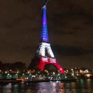 As Paris mourns after the terrorist attacks, the Eiffel Tower was lit up Monday evening in France's tricolor. (Credit: Karin Caifa/CNN)