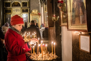 A woman lights a candle during a requiem in memory of the victims of the plane crash in Kazan Cathedral on Nov. 1, 2015, in St. Petersburg, Russia. That day was announced as a day of mourning in memory of the victims. (Credit: Alexander Aksakov/Getty Images)