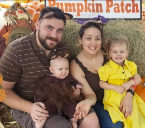 A photo provided by his family shows Greg Hoke, his wife Nikki and children Everette and Hollace.