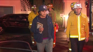 Johnny Mathis arrives at his home minutes after a fire breaks out on Nov. 2, 2015. (Credit: KTLA)