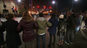 Demonstrators take to the streets in protest after the release of video showing the 2014 shooting death of Laquan McDonald by a Chicago police officer. (Credit: CNN)