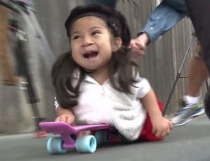 Miracle Perez plays on a skateboard on Nov. 25, 2015. (Credit: KTLA)