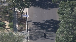 An officer-involved shooting scene was blocked off in Lake Balboa on Nov. 9, 2015. (Credit: KTLA)