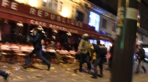 People run after hearing what is believed to be explosions or gun shots near Place de la Republique square in Paris on November 13, 2015. At least 18 people were killed in several shootings and explosions in Paris today, police said. (Credit: Getty Images)