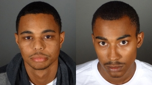 Christopher Savery, 23, left, and Cory Hartfield, 19, are seen in booking photos. (Credit: Pasadena Police Department)