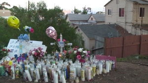 A growing memorial was placed at the site where the 14-year-old girl's body was found on Nov. 18, 2015. (Credit: KSWB)