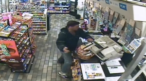 Authorities released surveillance video of a violent incident at a liquor store in Santa Fe Springs on Monday, Nov. 9, 2015. Credit: Whittier Police Department)