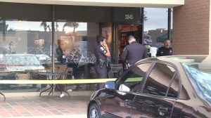 Police respond to a fatal confrontation at a Starbucks in Santa Ana on Nov. 24, 2015. (Credit: KTLA)