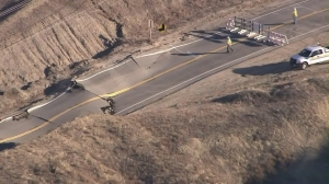 Sky5 aerials show a buckling Vasquez Canyon Road in Canyon County. (Credit: KTLA)