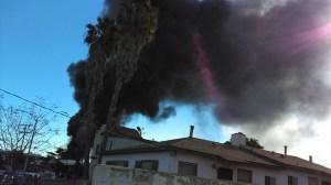 Smoke rose above Harbor Gateway as a massive fire burned at a recycling yard on Dec. 12, 2015. (Credit: Antonio De Jesus Osuna)