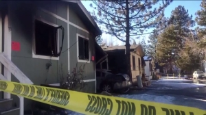The children's father tried to extinguish the fire, which authorities said began an outdoor carport. (Credit: KTLA)