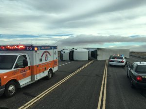 An overturned big rig is seen in lanes in the Mojave area on Dec. 22, 2015. (Credit: Brandon Vaccaro/California City Fire Rescue)