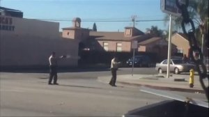 A screenshot from a witness's video appears to show Los Angeles County sheriff's deputies fatally shooting a man near a gas station in Lynwood on Dec. 12, 2015.