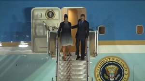 President Barack Obama and first lady Michelle Obama disembark from Air Force One at San Bernardino International Airport on Dec. 18, 2015. (Credit: Pool)