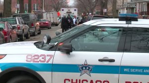 An investigation was underway on Dec. 26, 2015, in Chicago after police fatally shot two people. (Credit: WGN)