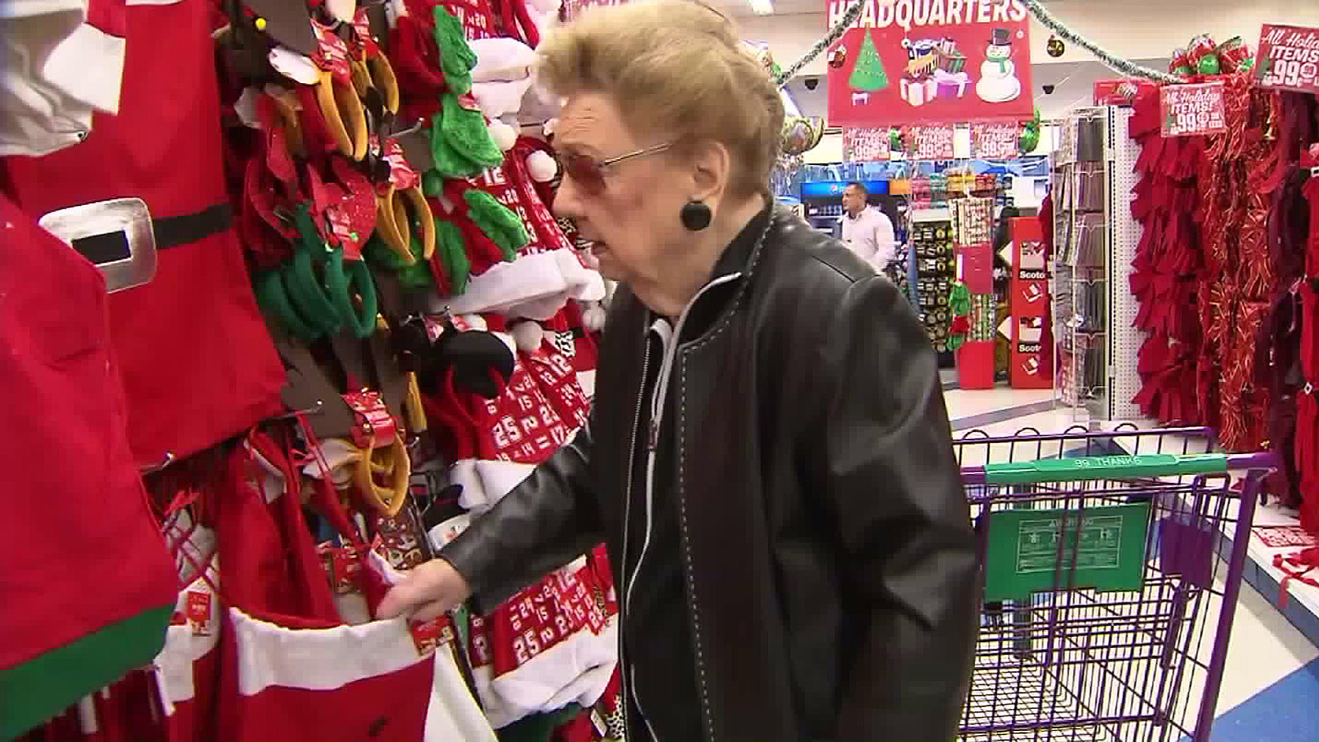 Donna Goldstein, 99, picks out Christmas items to donate during a shopping spree at a 99 Cents Only Store on her birthday on Dec. 10, 2015. (Credit: KTLA)