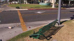 An overturned bench is seen following a fatal hit-and-run crash in Santa Ana Tuesday. (Credit: KTLA)
