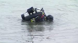 A diver searches a San Bernardino lake during an FBI investigation on Dec. 10, 2015. (Credit: KTLA)