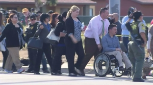 People are escorted away from the scene of a shooting in San Bernardino on Dec. 2, 2015. (Credit: KTLA)