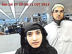 Tashfeen Malik and Syed Rizwan Farook were photographed at O'Hare Airport in July 2014. (Credit: Chicago O'Hare Airport via CNN Wire)