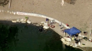 FBI divers search Seccombe Lake on Dec. 10, 2015. (Credit: KTLA)