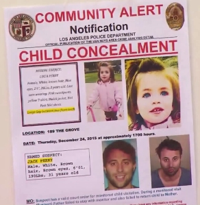 Lucia Perry and her father Jack Perry are shown on a flier displayed at an LAPD news conference on Dec. 28, 2015. (Credit: KTLA)