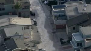 A Ventura street was flooded amid high surf along the coast on Dec. 11, 2015. (Credit: KTLA)