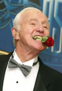 Famed cinematographer Haskell Wexler poses with a rose in his mouth at the American Society of Cinematographers 17th Annual Outstanding Achievement Awards at the Century Plaza Hotel on Feb.16, 2003, in Los Angeles. (Credit: Kevin Winter/Getty Images)
