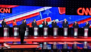 Republican presidential candidate businessman Donald Trump, center, speaks during the Republican Presidential Debate, hosted by CNN, at The Venetian hotel-casino on Dec. 15, 2015 in Las Vegas, Nevada. (Credit: Robyn Beck/AFP/Getty Images)