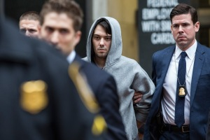 Martin Shkreli, center, CEO of Turing Pharmaceutical, is brought out of 26 Federal Plaza by law enforcement officials after being arrested for securities fraud on Dec. 17, 2015, in New York City. Shkreli gained notoriety earlier this year for raising the price of Daraprim, a medicine used to treat the parasitic condition of toxoplasmosis, from $13.50 to $750, though the arrest does not involve that price hike. (Credit: Andrew Burton/Getty Images)