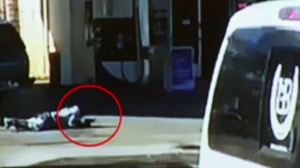 A video still frame provided by the L.A. County Sheriff's Department appears to show a suspect holding a gun at a Lynwood gas station.