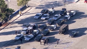 Los Angeles Police Department patrol cars and SWAT vehicles were staged outside the Los Angeles Memorial Coliseum following an unspecified threat to several LAUSD schools on Dec. 15, 2015. (Credit: KTLA)
