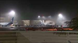 Foggy conditions prompted a ground stop for some arriving flights at Los Angeles International Airport on Dec. 9, 2015. (Credit: KTLA)
