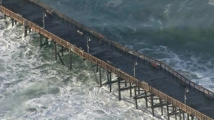 The Ventura pier appeared to be damaged as strong surf pounded the coast on Dec. 11, 2015. (Credit: KTLA)