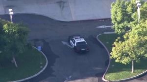 An LAPD car is seen outside Ramon C. Cortines School in Los Angeles among a district-wide closure of campuses on Dec. 15, 2015. (Credit: KTLA)