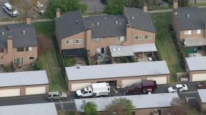Investigators work on Dec. 3, 2015, at a Redlands home rented by the couple who opened fire in San Bernardino the previous day. (Credit: KTLA)