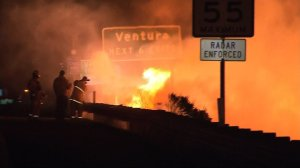 The Solimar Fire comes up against the 101 Freeway in Ventura County on Saturday. (Credit: KTLA)
