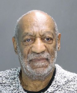 Bill Cosby has been charged with sexual assault in relation to a 2004 accusation in Montgomery County, Pennsylvania. He is seen here in a booking photo. (Credit: Montgomery County district attorney)