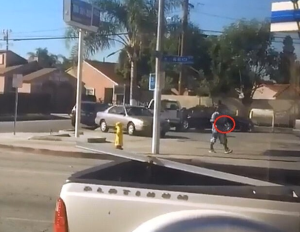 The Los Angeles County Sheriff's Department provided this still image from surveillance footage that the department says shows a man holding a gun before he was shot and killed by deputies in Lynwood on Dec. 12, 2015.