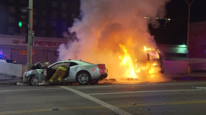 A fiery and deadly crash is pictured in Hollywood on Dec. 28, 2015. (Credit: KTLA)