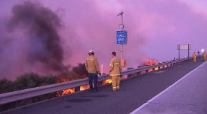 Firefighters assess the Solimar Fire in Ventura County, off the 101 Freeway, on Saturday. (Credit: KTLA)